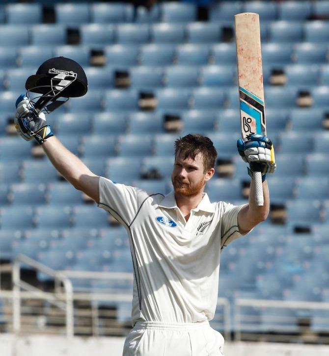 Neesham raises his bat and helmet after scoring his second Test century