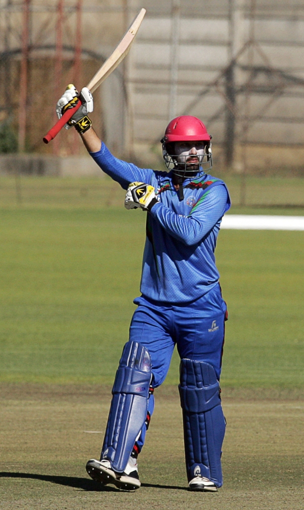 Ahmadi celebrates after bringing up his half-century