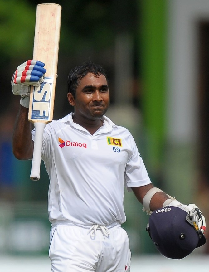 Jayawardene celebrates after bringing up his century