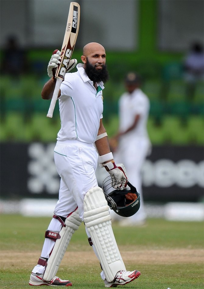 Amla celebrates after scoring his maiden Test century against Sri Lanka