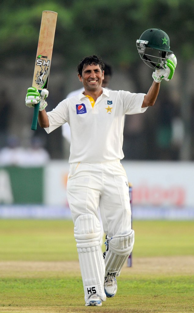 Khan celebrates after bringing up his 24th Test century