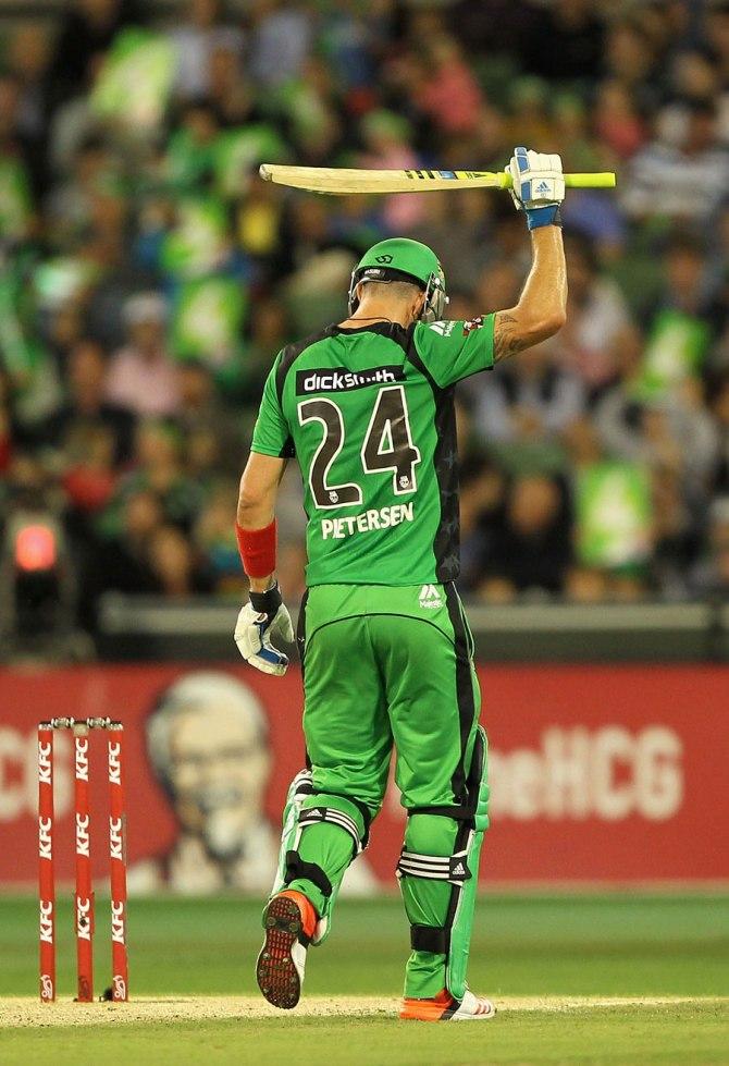 Pietersen raises his bat after bringing up his half-century