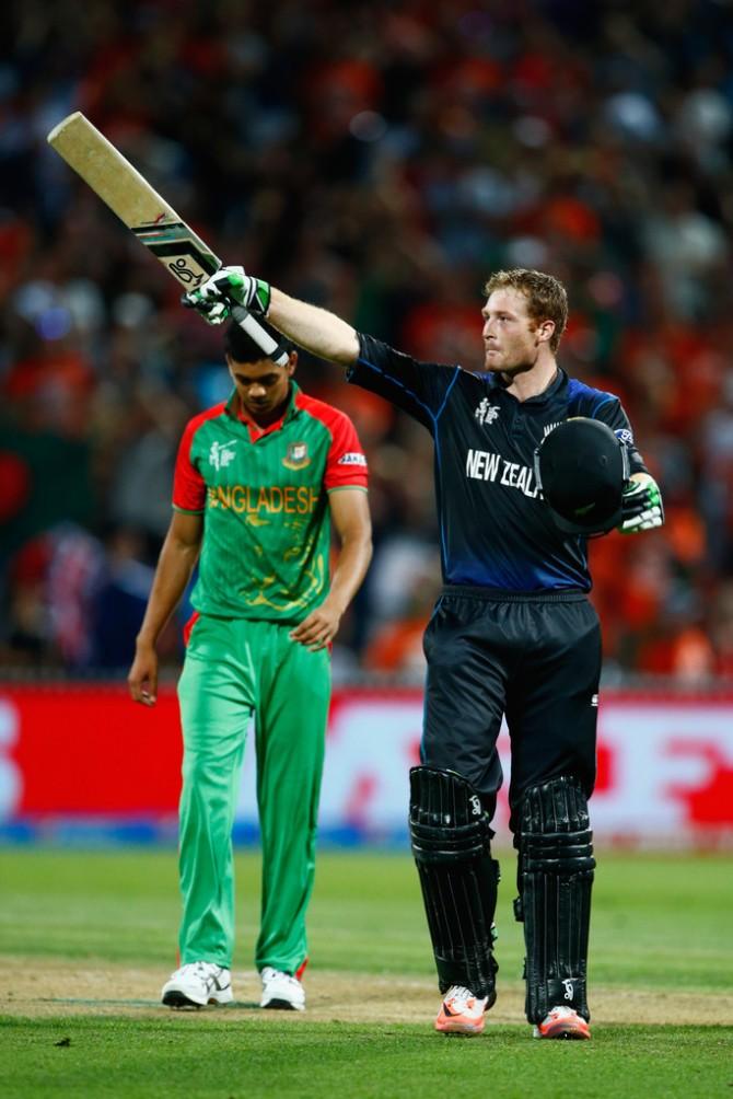 Guptill celebrates after scoring his sixth ODI century