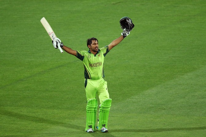 Ahmed celebrates after scoring his maiden ODI century