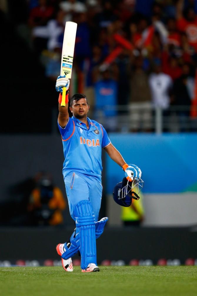 Raina raises his bat after bringing up his fifth ODI century