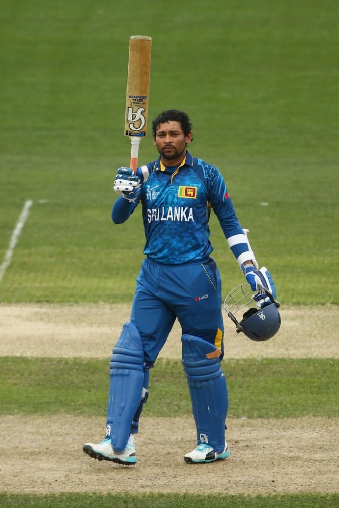 Dilshan raises his bat after bringing up his 22nd ODI century