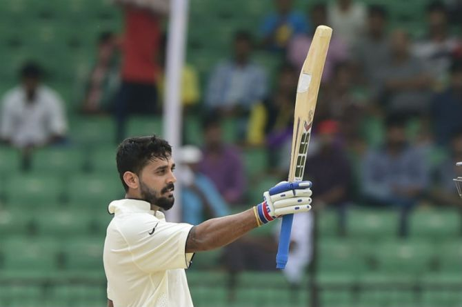 Vijay celebrates after scoring his sixth Test century