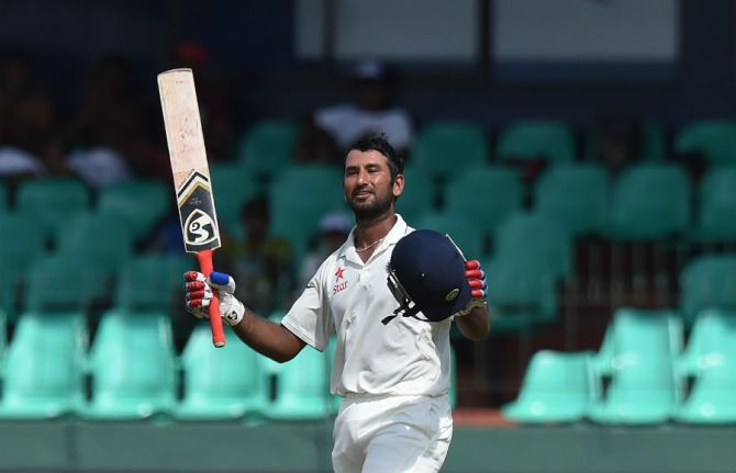 Pujara celebrates after scoring his seventh Test century