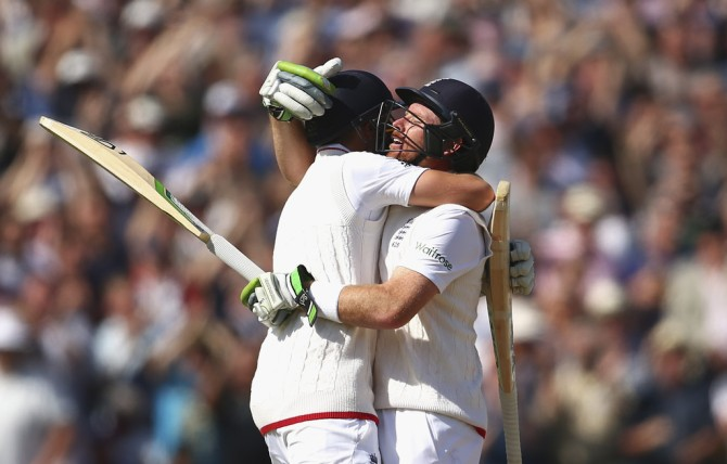 Root (left) and Bell (right) celebrate after leading England to victory