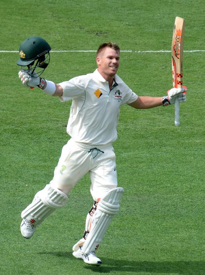 Warner celebrates after scoring his 13th Test century