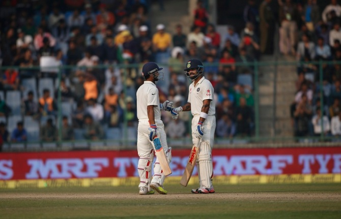 Rahane (left) and Kohli (right) remain unbeaten on 52 and 83 respectively