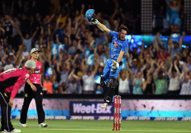 Head leaps in the air in delight after scoring his century and leading his side to victory