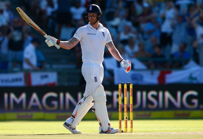 Stokes raises his bat after bringing up his half-century