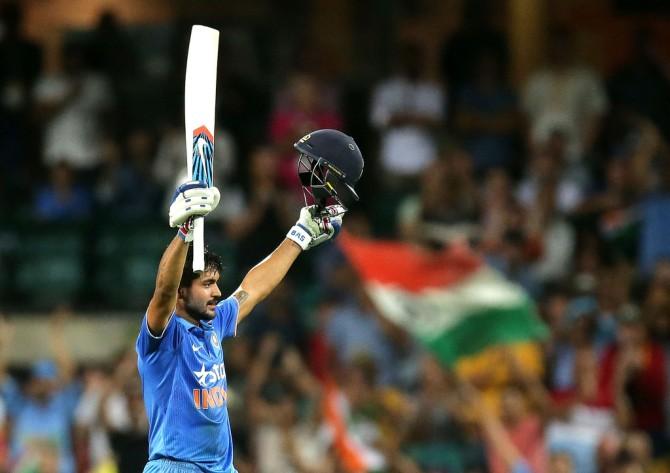 Pandey celebrates after scoring his maiden ODI century