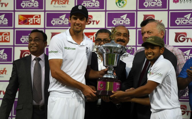 Cook and Rahim pose with the trophy after the series finished as a 1-1 draw